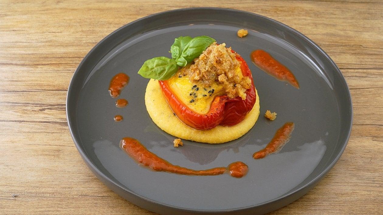 Paprika gefüllt mit  Polenta unter der Kartoffel-Kruste
