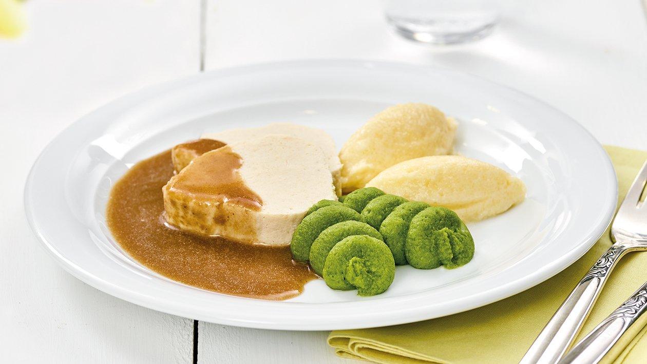 Geschmorte Kalbshaxe mit Kartoffelpüree und Lauch in pürierter Form