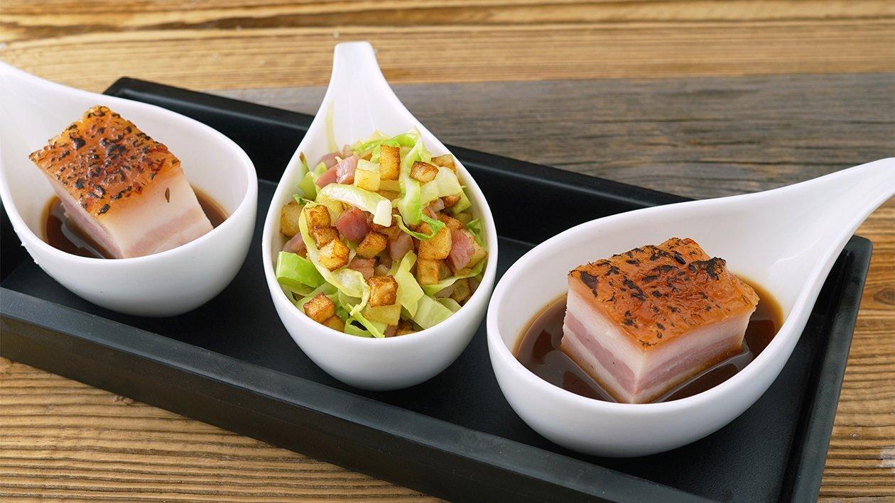 Krosser Schweinebauch mit Portweinsoße und Speck-Kartoffel-Kohl